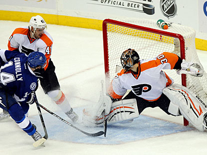 Brett Connolly puts the puck past goalie Ilya Bryzgalov halfway through overtime to lift the Lightning. (US Presswire)