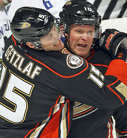 Corey Perry (right) celebrates one of two goals on the power play in the second period. (Getty Images)