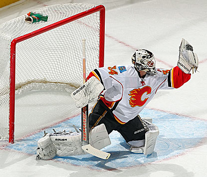 Miikka Kiprusoff makes 36 saves to help the Flames overtake the Avalanche. (Getty Images)