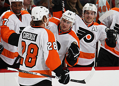 Claude Giroux and teammates celebrate after one of Giroux's two goals on the night. (Getty Images)