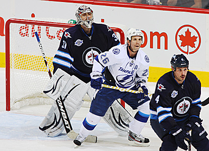 Goalie Ondrej Pavelec sends back 30 saves to help the Jets rout the Bolts at home. (Getty Images)