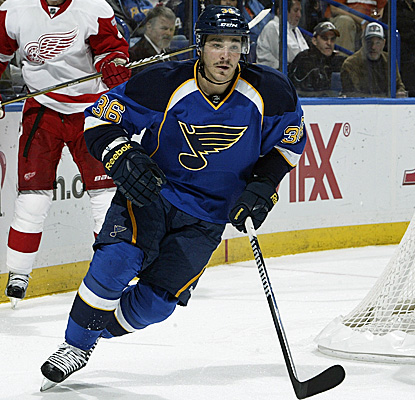 Matt D'Agostini scores a power-play goal for the Blues, ending the Red Wings' four-game winning streak. (Getty Images)
