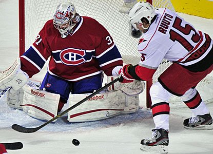 Carey Price, who also notches a secondary assist on a Montreal goal, denies Tuomo Ruutu for one of his saves. (AP)
