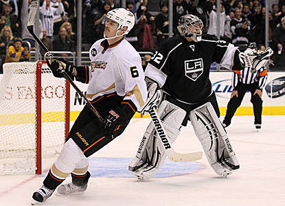 Jonathan Quick (right) sends away a lot of disappointed Ducks with 23 saves in regulation, and 6 out of 7 in the shootout. (Getty Images)