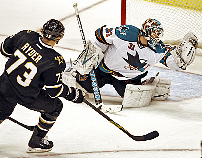 The Sharks' Antti Niemi (right) stops 30 shots in Dallas' defeat against San Jose. (AP)