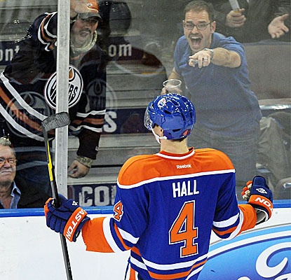 Edmonton's Taylor Hall celebrates his third goal with fans in the Oilers' big win over the Chicago Blackhawks. (AP)