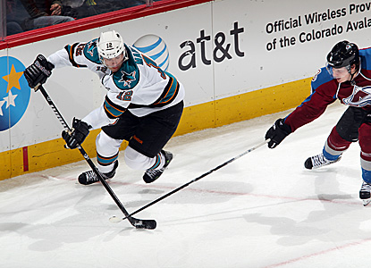 Patrick Marleau (left) explodes for a hat trick against the Avs, including two goals in the second period. (Getty Images)