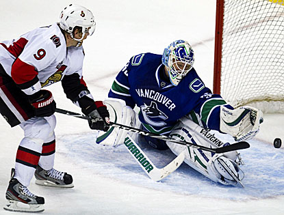 In the absence of an injured Roberto Luongo, Cory Schneider stops 28 shots from the Ottawa Senators to aid in Vancouver's win. (AP)