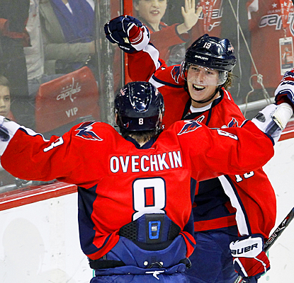 Washington's Nicklas Backstrom (right) celebrates his third-period goal with Alex Ovechkin. (AP)