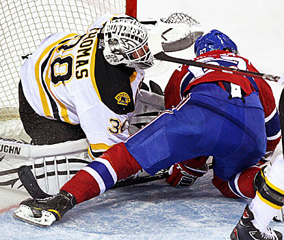 Tim Thomas (left) stops 33, earning the Bruins their second shutout in a row against Montreal. (AP)