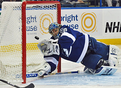 Dwayne Roloson can't stop a shot by Tyler Bozak, who scores two goals for the Maple Leafs. (Getty Images)