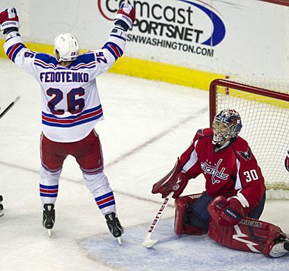 Ruslan Fedotenko beats Michal Neuvirth in the third period to cap the scoring with New York's sixth goal. (AP)