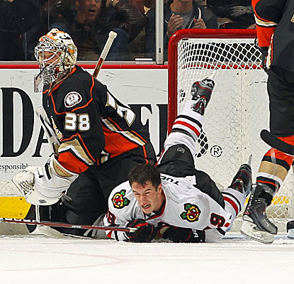 Chicago's Jonathan Toews loses his helmet after scoring his second goal against Anaheim. (Getty Images)