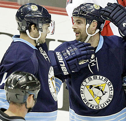 Penguins' Chris Kunitz congratulates Steve Sullivan, who scores in the first period against the Ottawa Senators. (AP)