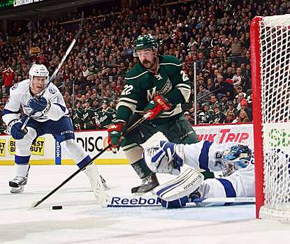 Cal Clutterbuck (center) scores a short-handed goal in the second period to help Minnesota top Tampa Bay. (Getty Images)