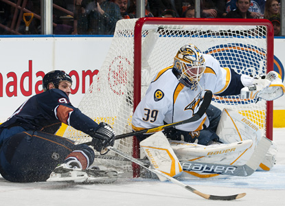 Anders Lindback plays through an injury to earn his first win of the season for Nashville. (Getty Images)