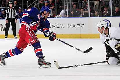 Brad Richards follow through on his shot for the Rangers' third of four goals in the second period. (AP)