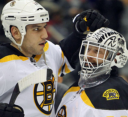 Milan Lucic, who tallies two goals, and Tim Thomas help the Bruins go 12-0-1 in November. (US Presswire)