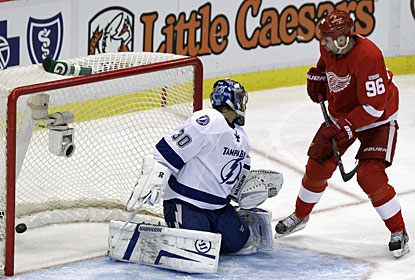 Tomas Holmstrom deflects the puck past Dwayne Roloson for his fourth goal this season. (AP)
