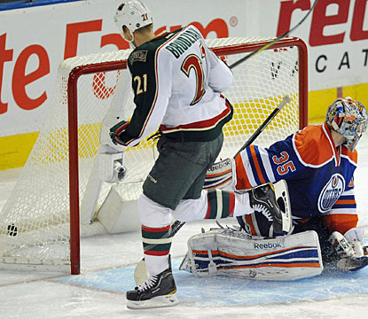 Kyle Brodziak helps his team in a couple of ways in Edmonton, scoring in regulation and also the winner in the shootout. (AP)