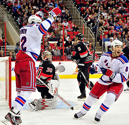 Artem Anisimov and Brandon Prust (8) celebrate Ryan McDonagh's (not pictured) goal. (Getty Images)