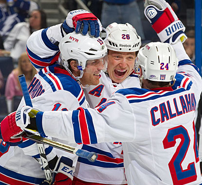 Ruslan Fedotenko (center) celebrates his goal with Brad Richards, who also gets an empty netter, and Ryan Callahan. (Getty Images)