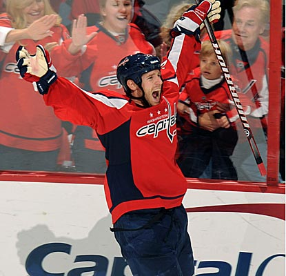 Washington's Brooks Laich scores the game-winning goal 12 seconds into OT in his 500th career game. (Getty Images)