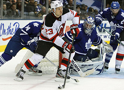 David Clarkson scores on the power play in the first period, then helps the Devils with the winner in overtime. (US Presswire)