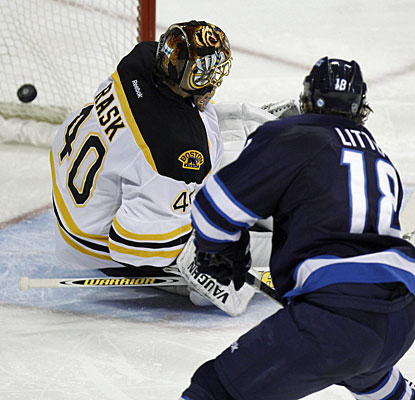 After a rush down the side, Bryan Little beats Tuukka Rask for what turns out to be the winning goal. (AP)