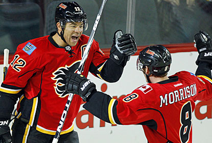 Jarome Iginla celebrates one of his two goals with Brendan Morrison, who also scores a pair of markers for Calgary. (AP)