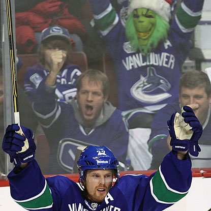 The Grinch is a Canucks fan? Daniel Sedin and fans enjoy the first of his three goals in the game. (AP)