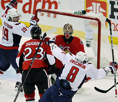 Alex Ovechkin slaps a shot past Craig Anderson for one of two Capitals goals in a span of 15 seconds. (AP)