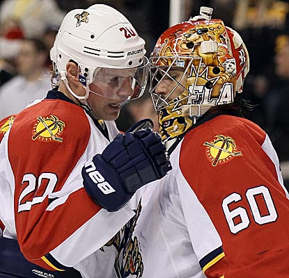 Panthers goalie Jose Theodore is congratulated after he stops 40 shots in shutting out the Bruins. (Getty Images)