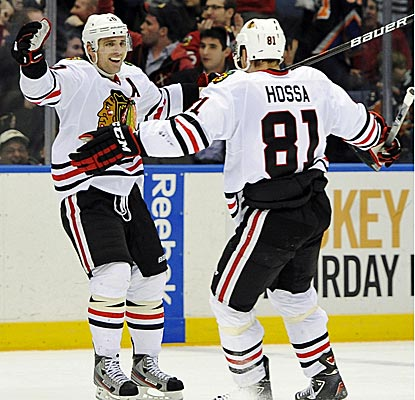 Chicago's Patrick Sharp scores two goals, including the game-winner in overtime against the Islanders. (AP)