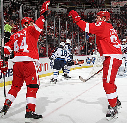 Todd Bertuzzi (44) and Johan Franzen celebrate one of the Red Wings' seven goals against the Jets. (Getty Images)