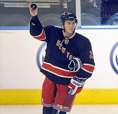 New York's Derek Stepan takes a curtain call after notching three points, including a pair of goals.  (AP)