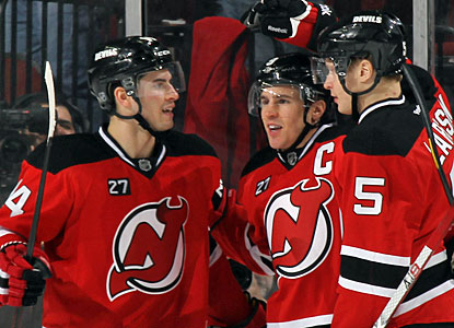 After setting up three goals for New Jersey, Zach Parise (center) gets to celebrate a goal of his own. (Getty Images)