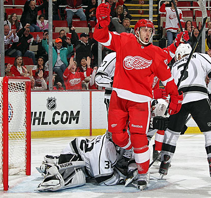 Drew Miller gets the first of two goals in a 15-second span in the first period and adds his second goal in the third. (Getty Images)