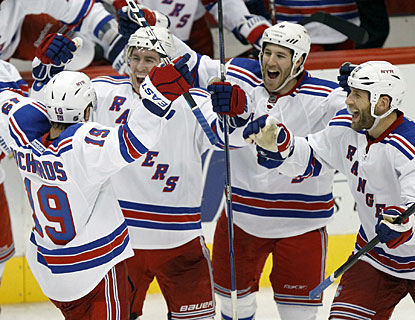 Talk about a reason to be excited like this. Brad Richards (19) gets it done for New York just before the final buzzer. (AP)