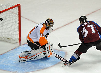 The Flyers' Ilya Bryzgalov can't stop Ryan O'Reilly's shot, which represents the winning goal in the shootout. (AP)