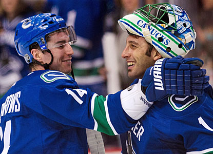 Alex Burrows, who scores for the fourth straight game, and Roberto Luongo play big against Detroit.  (Getty Images)