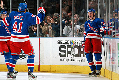 Stu Bickel (41) sets up Derek Stepan (right) for a goal. Bickel has points in each of his first three NHL games. (Getty Images)