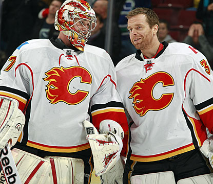 Leland Irving (left) gets kudos for his first career win from regular starter Miikka  Kiprusoff. (Getty Images)
