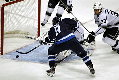 Evander Kane makes the home fans erupt when he scores this goal 69 seconds into overtime. (AP)