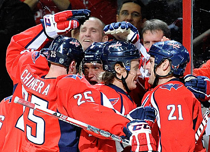Alexander Ovechkin, who scores two goals in a game for only the third time this season, is mobbed by teammates. (Getty Images)