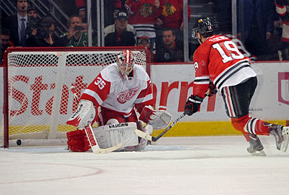 After being hooked, Jonathan Toews converts a penalty shot -- the second try of his career. (US Presswire)