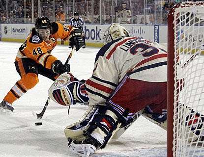 0d2aed8a1 Henrik Lundqvist secures the win for New York when he denies Danny Briere  on a penalty
