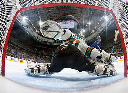 Antti Niemi stops Cody Hodgson in the SO to help San Jose beat Vancouver for the first time this season. (Getty Images)