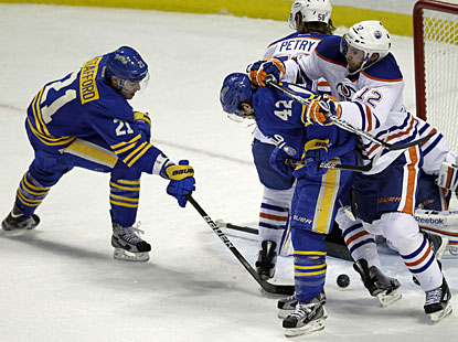 Drew Stafford scores the third goal for Buffalo and also assists on goals by Jordan Leopold and Nathan Gerbe. (AP)