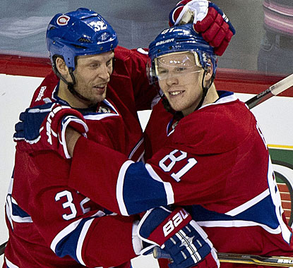 Not knowing what's coming, Lars Eller (right) is congratulated after the first of his four goals by Travis Moen. (AP)